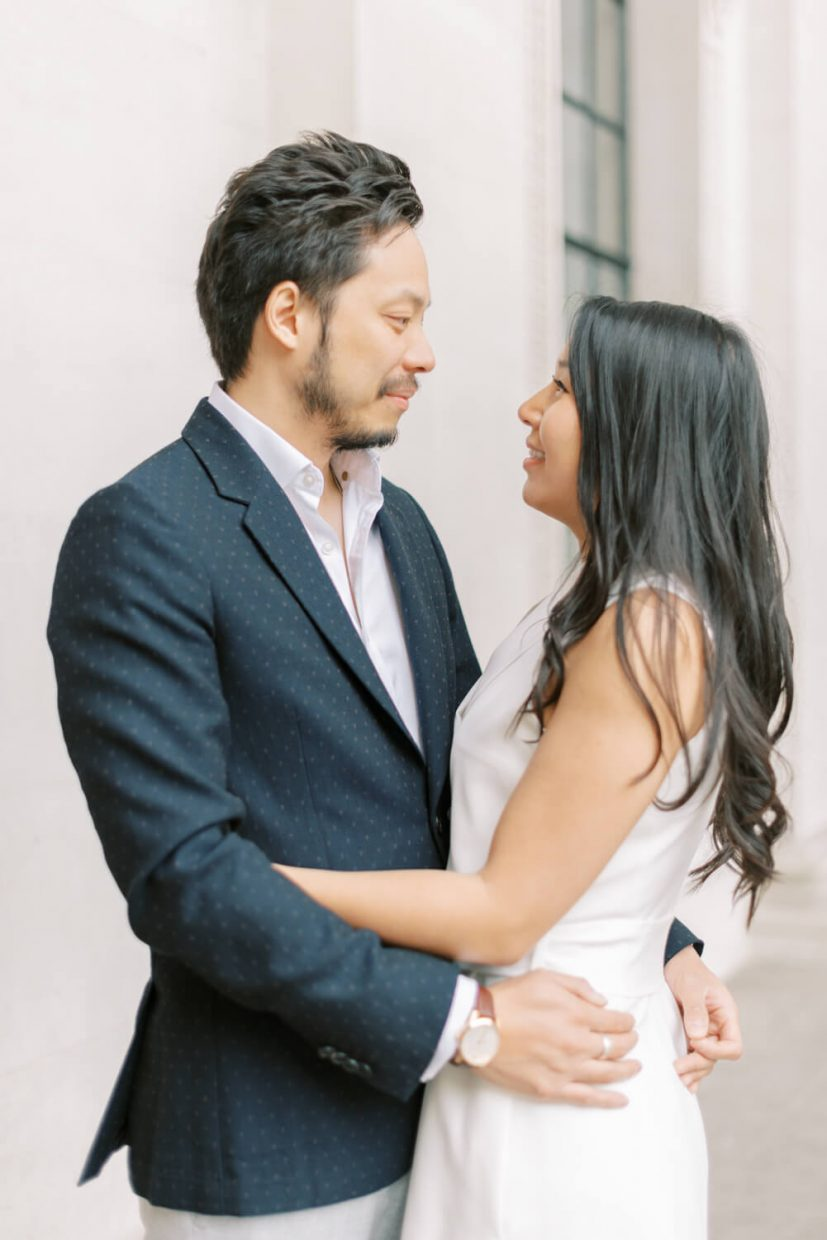 London Engagement Shoot in Kensington & Chelsea 10-11 Carlton House Terrace by Cristina Ilao Fine Art Wedding Photography   In Photo: Asian couple civil wedding ceremony semi formal outfit navy blue suit , white shirt, white mini dress, curled long black hair, white walls